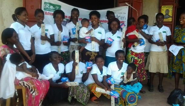 RIC-NET supports vulnerable children. Giving out sanitary towels to one of the Vulnerable child groups we support.